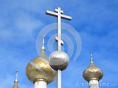 Orthodox cross against sky