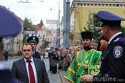 Orthodox Priest and Police Editorial Stock Photo