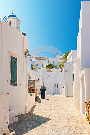 Orthodox priest in Sifnos alleyway