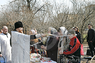 Orthodox priest spatter the holy water Editorial Image