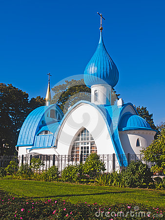 Orthodox white church with blue domes