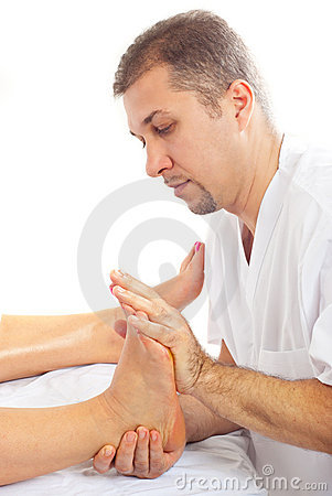 Orthopedist man massaging foot
