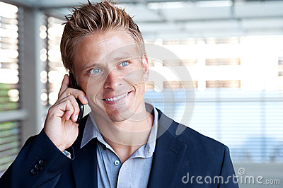Ortrait of handsome business man using cell phone