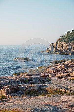 Free Otter Cliffs In The Background With Slabs Of Pink Granite Rocks Royalty Free Stock Images - 44963199