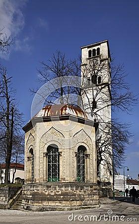 Free Ottoman Tomb And Church Of St. Antun – Clock Tower (Sahat Kula) In Bihac. Bosnia And Herzegovina Royalty Free Stock Image - 61987976