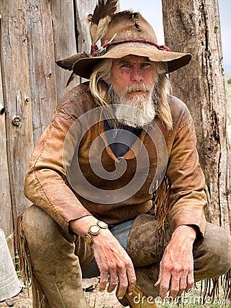 Oude doorstane cowboy