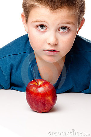 Oung Boy deciding to eat an apple