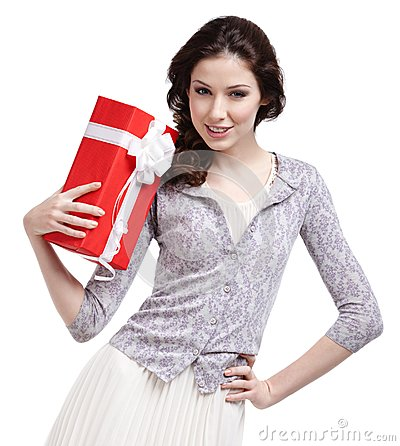 Oung woman hands a Christmas gift