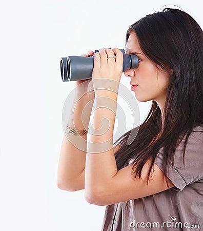Oung woman using binoculars isolated