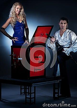 Ouple performing sword box illusion