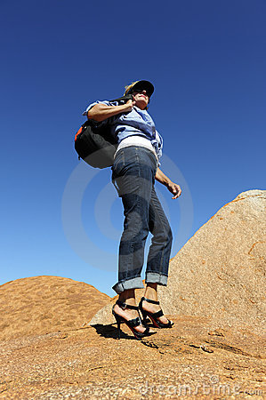 Outback Woman Walking in High Heels