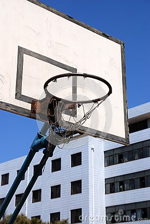 Outdoor basketball hoop against blue sky