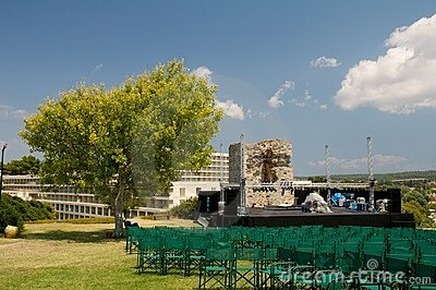 Outdoor concert stage. Tree in shape of tree