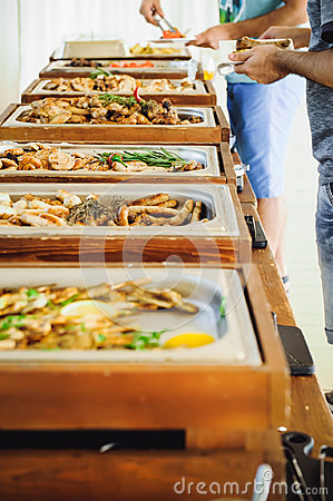 Free Outdoor Cuisine Culinary Buffet Dinner Catering. Group Of People In All You Can Eat. Dining Food Celebration Party Concept. Servic Stock Photography - 98890252