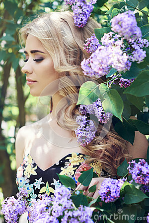 Free Outdoor Fashion Beautiful Young Woman Surrounded By Lilac Flowers Summer. Spring Blossom Lilac Bush. Portrait Of A Girl Blond Stock Photography - 96389222