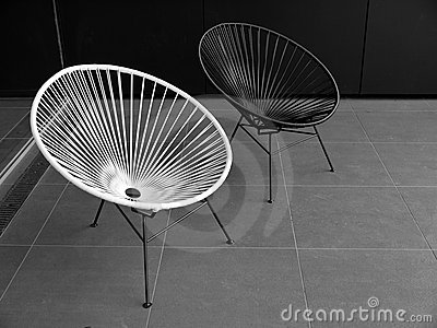 Outdoor furniture: black and white chairs