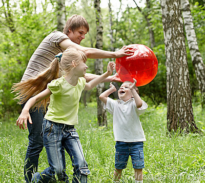 Free Outdoor Happy Family Plaing Ball . Stock Photography - 14435632