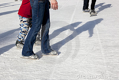Outdoor Ice Skaters and Shadows