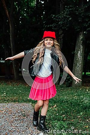 Free Outdoor Lifestyle Portrait Of Stylish Little Girl Teenager On City Park. . Beautiful Child, Wearing. Stock Photo - 103783260