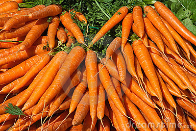 Outdoor market with fresh carrots in Paris
