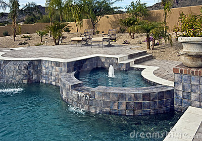 Outdoor pool with spa and fountain