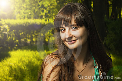 Outdoor portrait of beautiful smiling girl