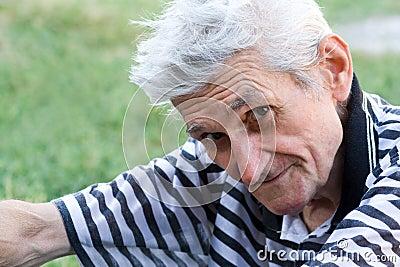 Outdoor portrait of calm serene senior man