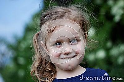 Outdoor portrait of cute girl