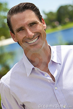 Outdoor Portrait of Handsome Smiling Man