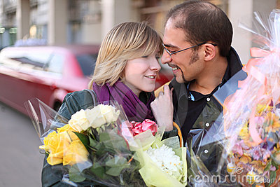 Outdoor portrait of man in glasses and beauty girl