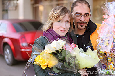 Outdoor portrait of man in glasses and blond girl