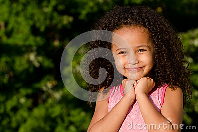 Outdoor portrait of pretty mixed race girl