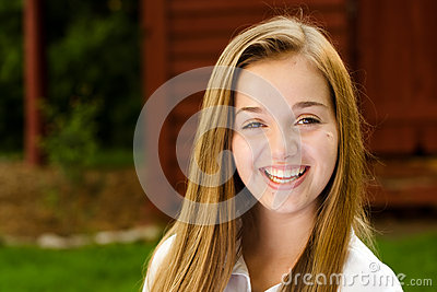 Outdoor portrait of pretty, young teen girl