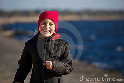 Outdoor portrait of running cheerful little girl
