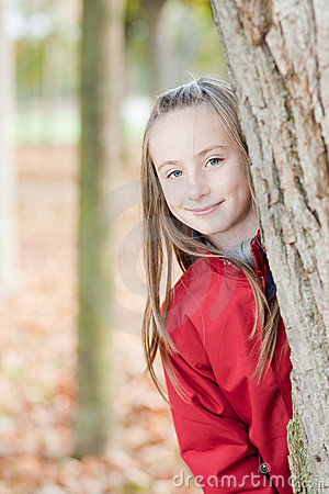 Outdoor portrait of a smiling girl