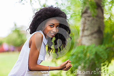 Outdoor portrait of a teenage black girl - African people
