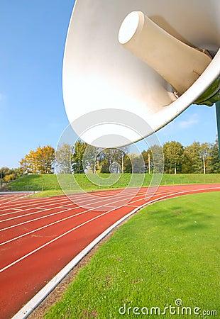 Outdoor racetrack for runners, with speaker