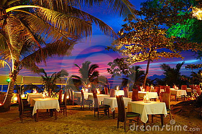 Outdoor restaurant at the beach during sunset