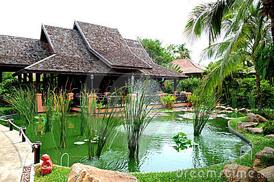 Outdoor restaurant and green pond
