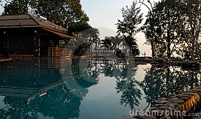 Outdoor swimming pool at dusk