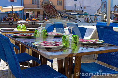 Outdoor wooden table set for dinner