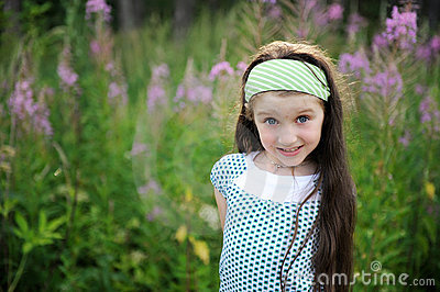 Outdoors portrait of adorable amazed child girl