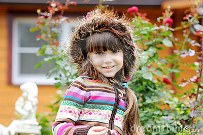 Outdoors portrait of adorable child girl in hood
