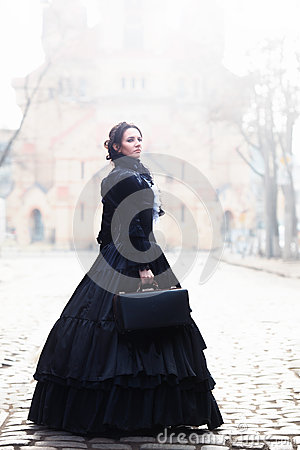 Free Outdoors Portrait Of A Victorian Lady In Black Stock Image - 94356891