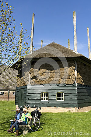 Free Outfitting Cyclists And Historic Hay Barn Royalty Free Stock Image - 37178156