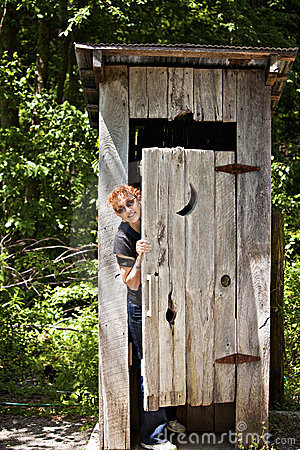 Outhouse With Woman Peeking Out Stock Images - Image: 15566514
