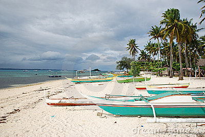Outrigger boats on tropical beach Editorial Photography