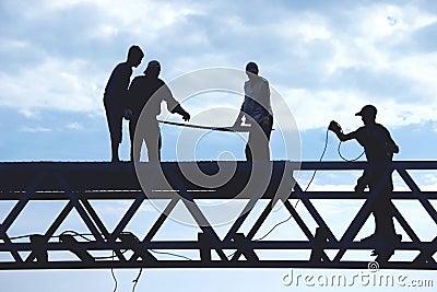 Ouvriers de silhouette