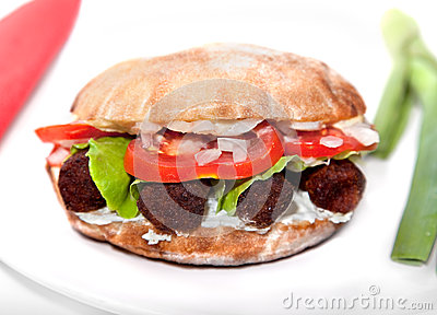 Oval vegan sandwich  with soya barbecue cevapcici