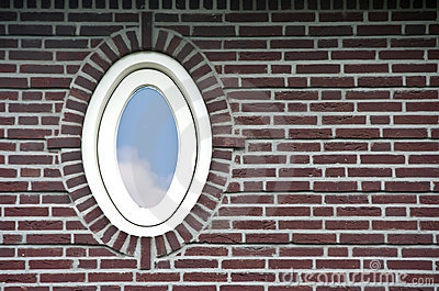 Oval window in brick wall